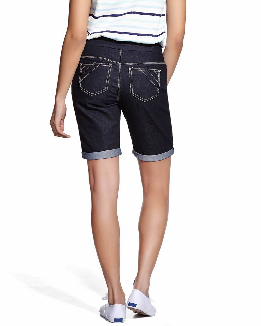These denim bermuda shorts feature an ab-solution elastic waist, fading and whiskering, two front pockets, two back pockets, two coin pockets, and a hidden tummy panel. .
