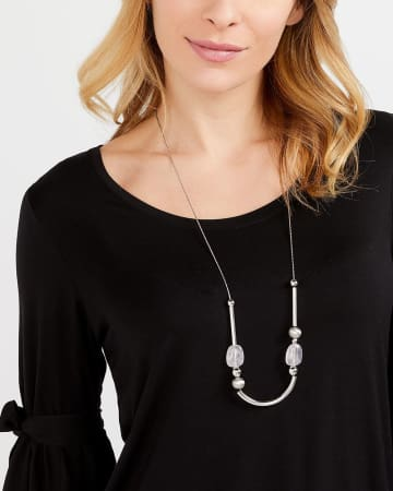 Collier long en demi-lune