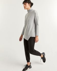 Turtleneck Sweater with Asymmetrical Hem